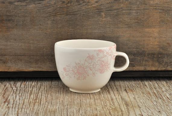 Porcelain coffee cup with vintage pink flower illustration