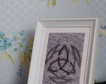 Framed embroidered Triquetra.