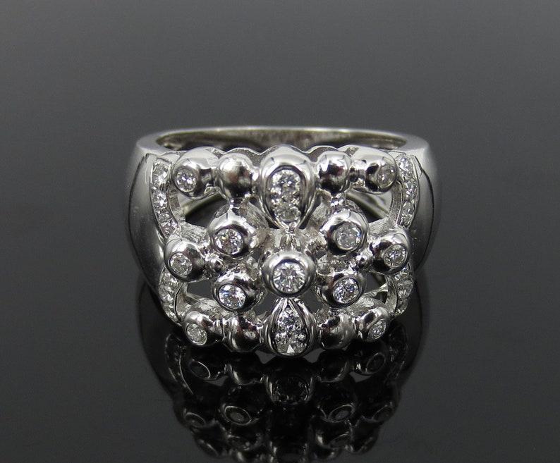 4efc56275d Fine 0.52ct FG/VS-VVS Diamond & 18K White Gold Snowflake   Etsy