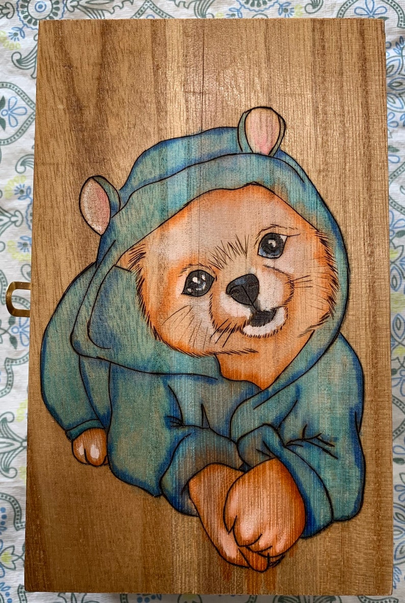 Rectangular shaped box wood birned with a puppy wearing pajamas