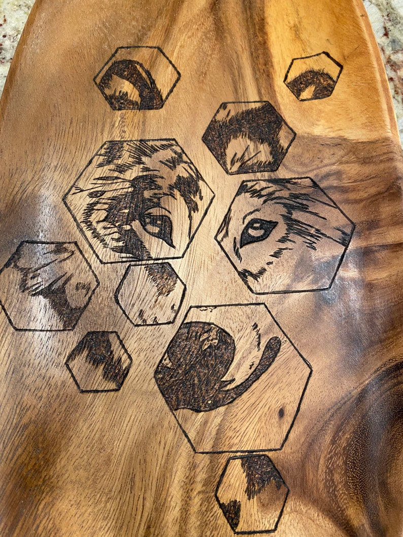 Gorgeous wooden platter wood burned with hexagons and a wolf