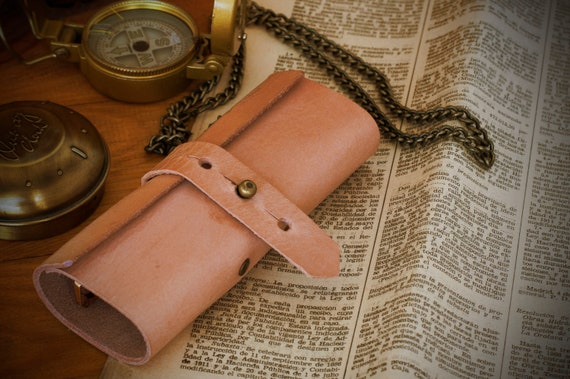 Handmade using premium leather. Glasses case. Low, secure and functional.