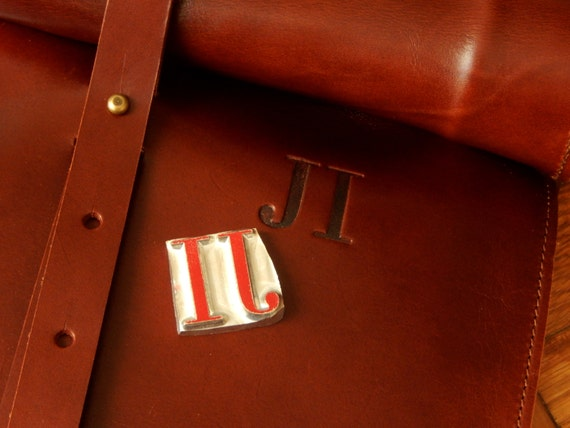 Relief in leather. Custom leather.  Engraving letters or drawings. Custom engraving leather.