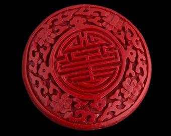 Carved red cinnabar disk. 55mm pkg of 1. B7-CIN017