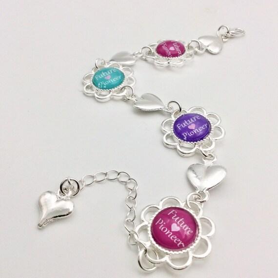 JW Future Pioneer Heart Bracelet, adjustable to fit child to adult.  Blue Velvet Gift Bag Included!