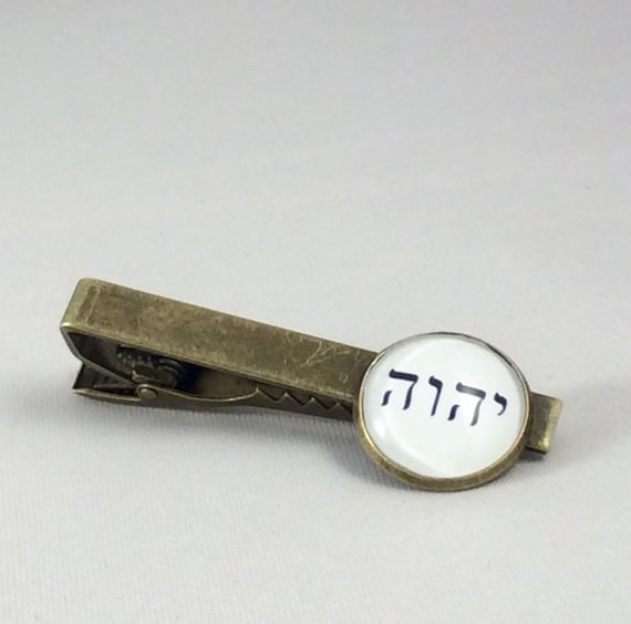 JW Tie Bar Tetragrammaton, Gold, White or Cinnamon.  Silver-tone or Antique Brass ,  Blue velvet gift pouch included.