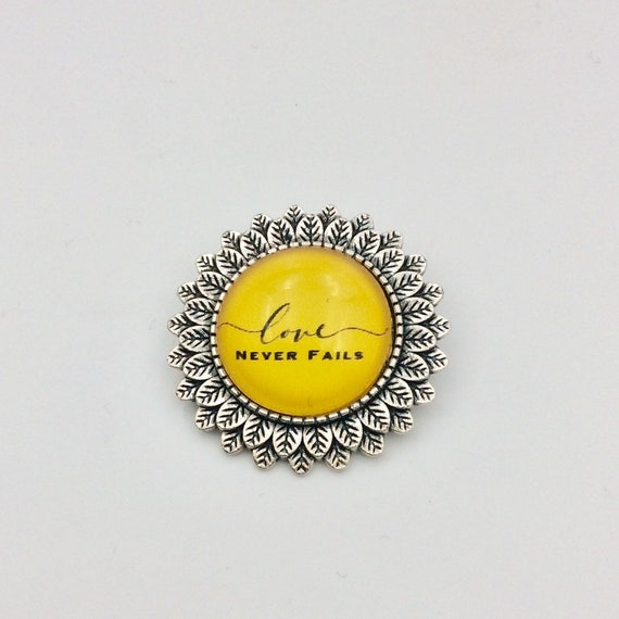 "Leaf Circle ""Love Never Fails"" Pin, Silver tone or Gold Tone, Available in Blue, Pink, White, and Yellow.  Blue Velvet Gift Bag Include"