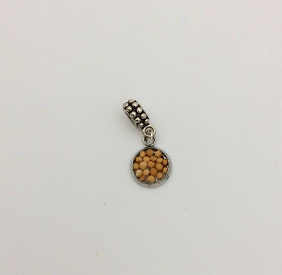 "JW Charm, Mustard Seed ""Faith"" European Style, Silver-tone.  Blue velvet gift pouch included."