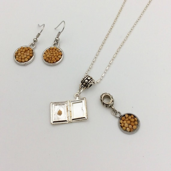 JW Mustard Seed Jewelry Set, featuring Bible locket with mustard seed inside. Matching earrings and bracelet charm.  All in silver plate