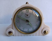 French vintage antique Art Deco SMI alarm clock, in amazing condition, with Bakelite case and brass adornments, circa 1920 30s.