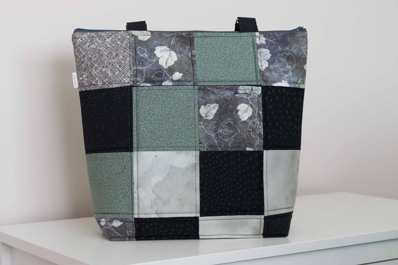 double handles pieced quilted padded zip top inside slip and zip pockets Stylin/' Squares Tote: large roomy interior 2 outside pockets