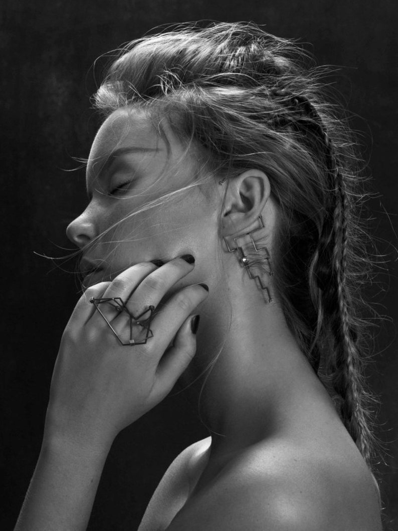 Behind the ear black Ear Cuff with an illusion of a minimalist tattoo contour line