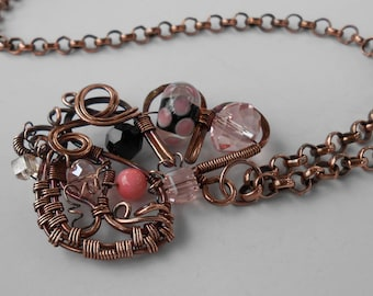 Necklace: Unique Handmade Copper Wire Wrapped Fairy Inspired Pendant with Pink, Black and Lampwork Glass Beads