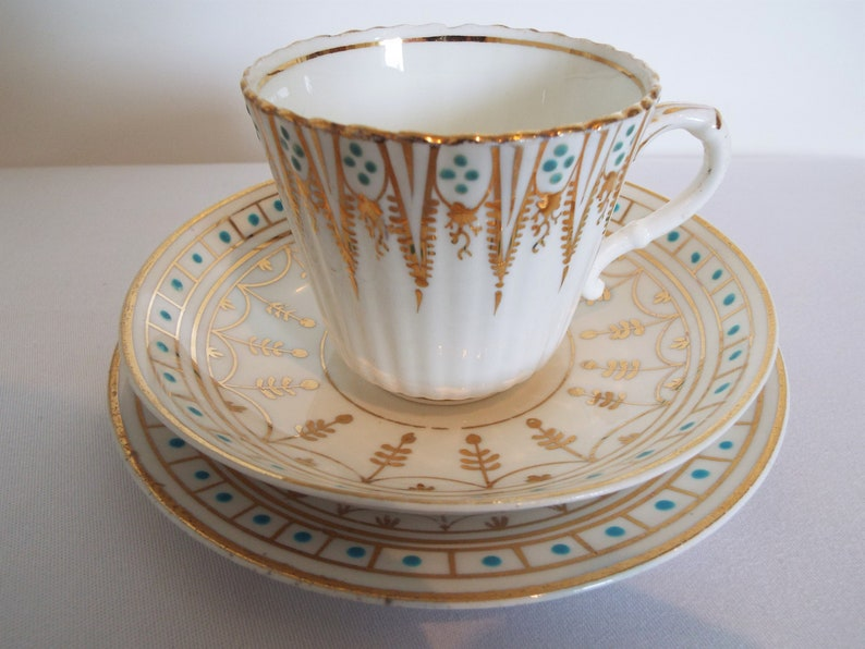 Victorian Teacup and Saucer And Cake Plate With Gold and image 0