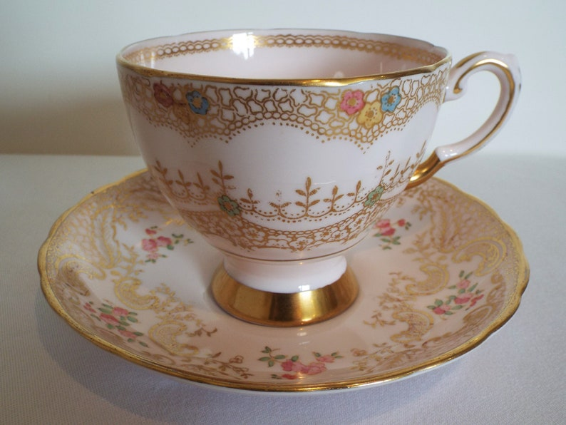 Vintage Pink Teacup and Saucer. 1947 Mismatched Tuscan Gold image 0