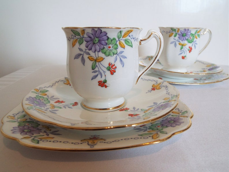 Vintage Teacup Trio With Purple Flowers Tulip Shape. Hand image 0