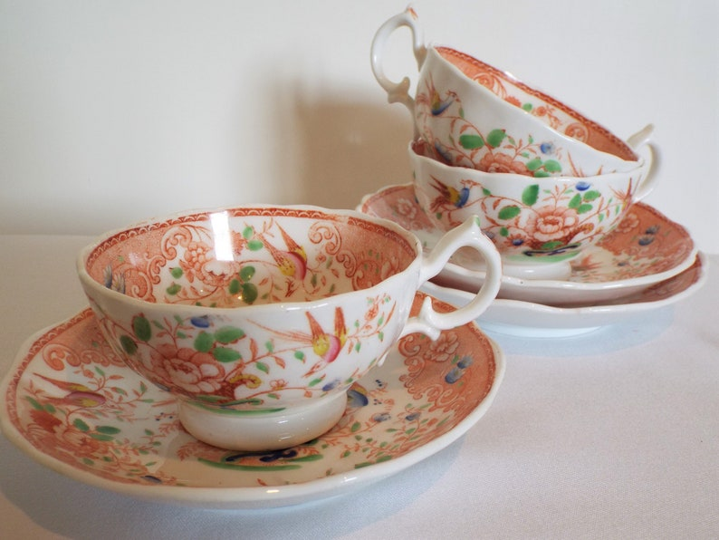 Antique Teacup And Saucer With Pink And Blue Birds. English image 0
