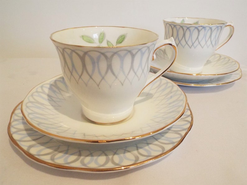 Vintage Blue And White Teacup And Saucer Hand Painted Blue image 0