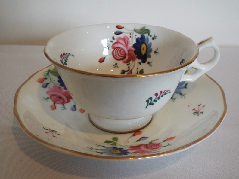Victorian Teacup and Saucer Entirely Hand Painted With Pink image 0