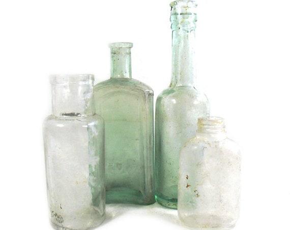 "7.5"" Tall Antique Set of Glass Bottles"