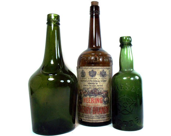 """11.5"""" Tall Vintage Set of Glass Drinks Bottles Including a Heering Cherry Brandy Bottle with Original Label"""