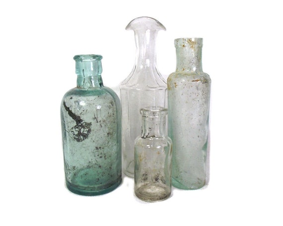 Antique Set of Aqua and Clear Glass Bottles