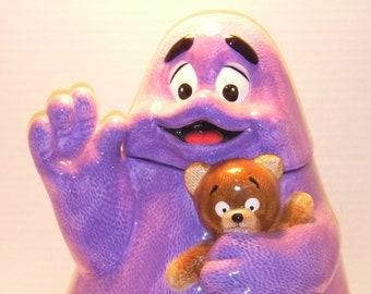 Grimace. McDonald's Treasure Craft Grimace Holding a Teddy Bear Cookie Jar     Treasure Craft 1997