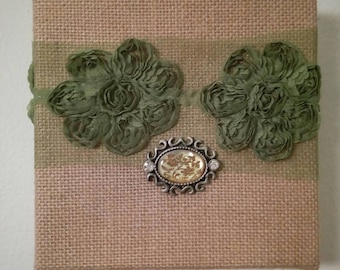Olive and gold; 6x6; original mixed media, lace and brooch on burlap canvas