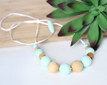 Silicone Teething Necklace for Mom - Nursing + Babywearing Distraction - Mint BPA free Chew Beads - Natural Wood Beads - Gift for Mom