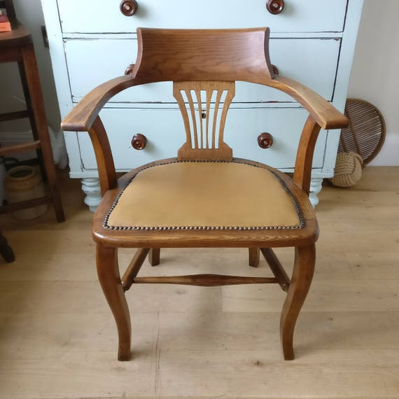 - Antique Captains Chair. Smokers Chair. Bow Chair. Office