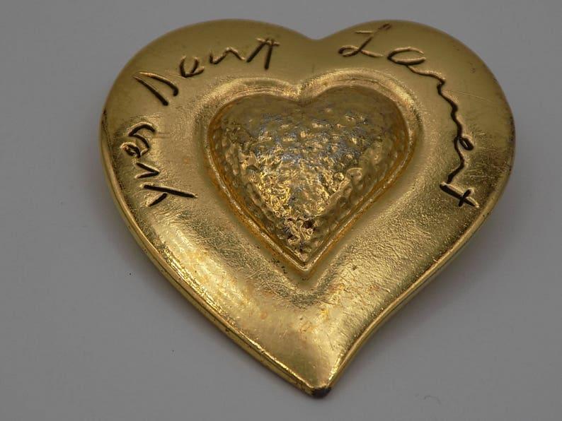 b437683071b87 Vintage Paris Golden brooch Yves Saint Laurent in the shape