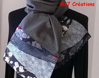 Scarf in grey and blue fabrics.
