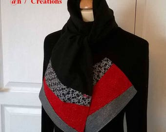 Black scarf with red and grey patterned ends.