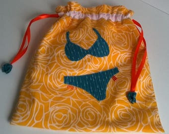 Green/blue and yellow fabric underwear bag.