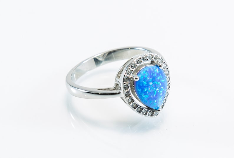 Pear-Shaped Lab Created Opal Micro Pave Ring