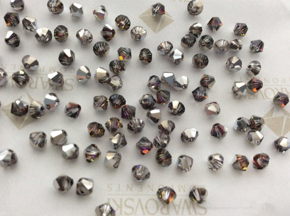 CRYSTAL VOLCANO 20 Perles Toupies 4mm cristal Swarovski