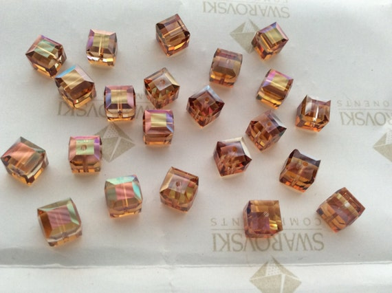 100 pcs Swarovski #5301 4mm Crystal Copper Bicone Faceted Beads