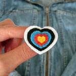 Heart shaped archery target brooch in felt handmade