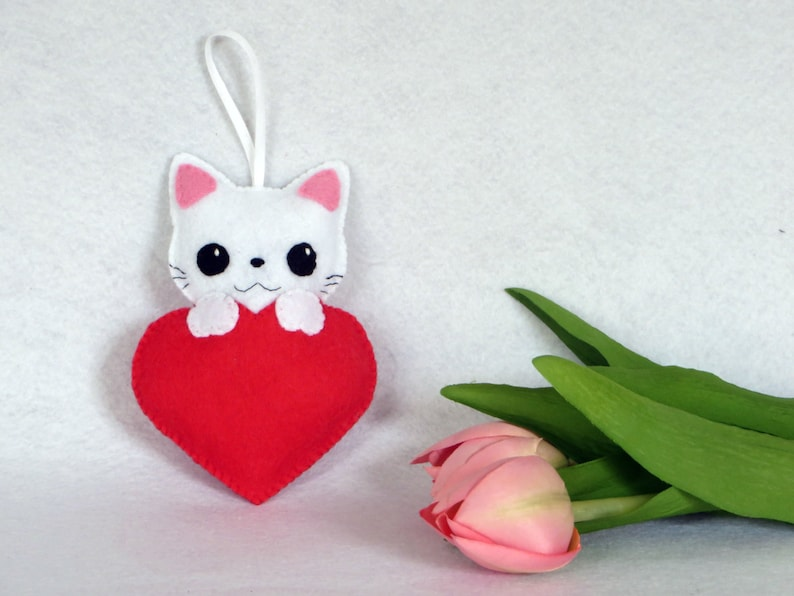 White cat plush in a red heart kawaii in felt handmade to image 0