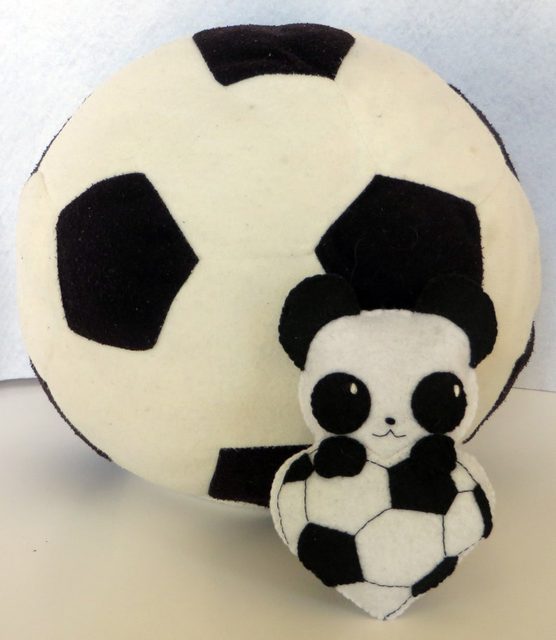 Soccer gift panda plush in a ball in shape of heart in image 0