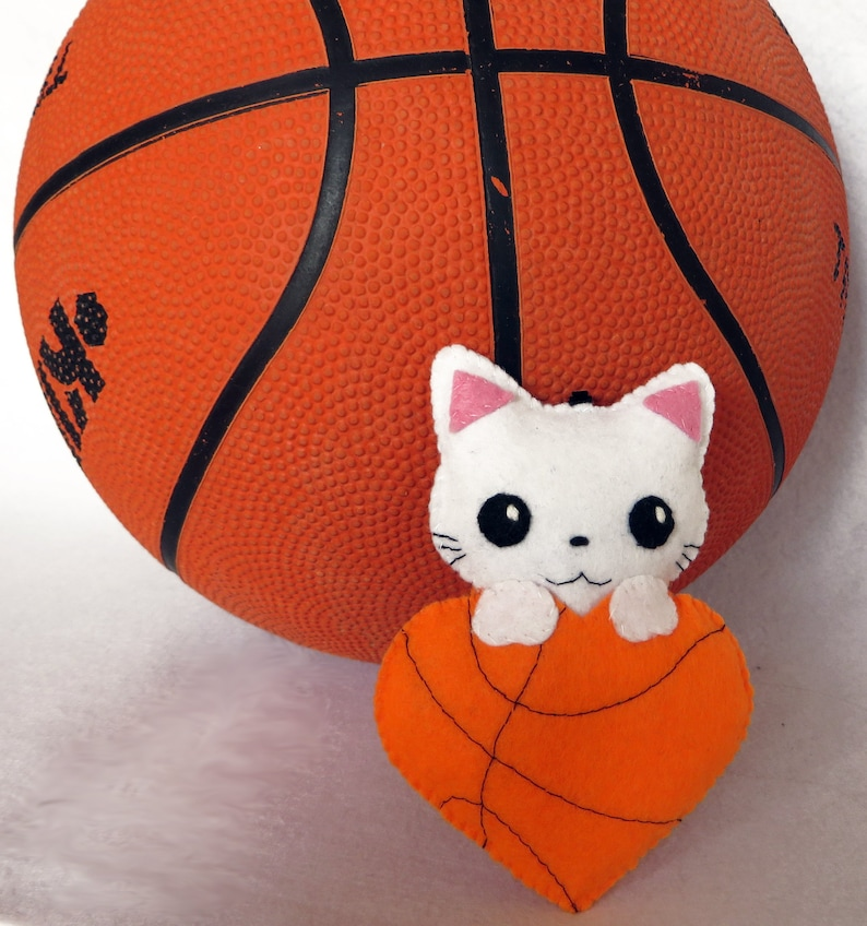 White cat plush kawaii in a heart in the colors of basketball image 0