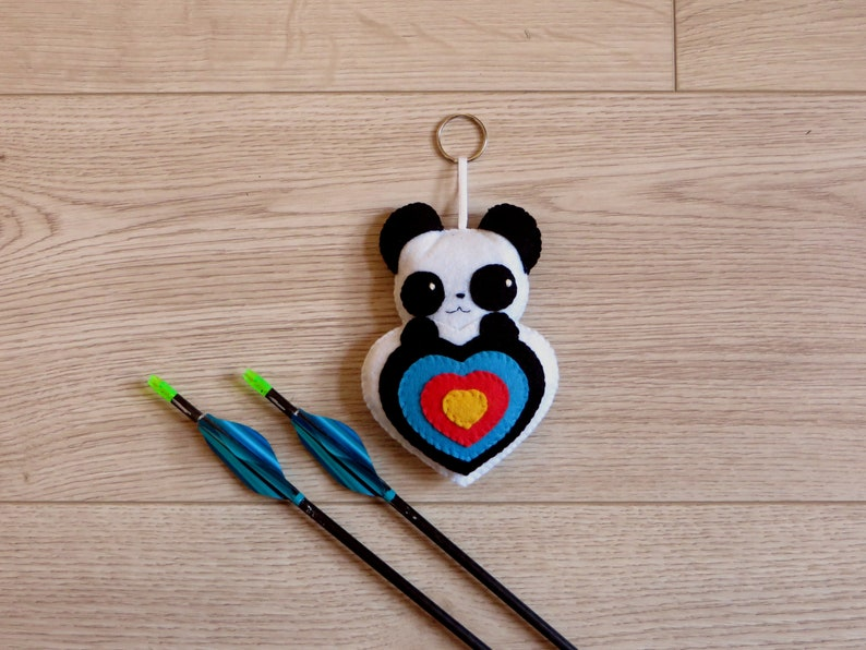 Archery quiver ornament panda plush in an archery target in image 0
