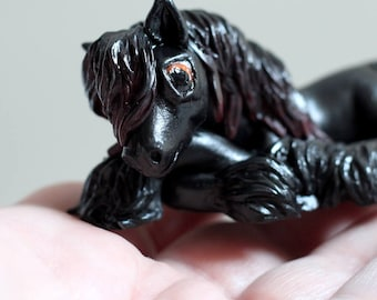 Bayly, miniature laying friesian colt/gelding sculpture handmade of polymer clay by Allison Muldoon/A57art