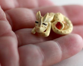 Meri, miniature sleeping golden sun dragon with agate and citrine stones, handmade of polymer clay by Allison Muldoon/A57art