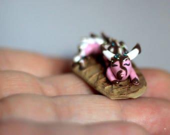 Sprinkles, miniature sleeping ice cream themed dragon handmade of polymer clay by Allison Muldoon