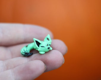 Edgar, miniature Frankenstein Halloween fantasy themed sleeping fox made of polymer clay handmade by Allison Muldoon/ChuckandStan