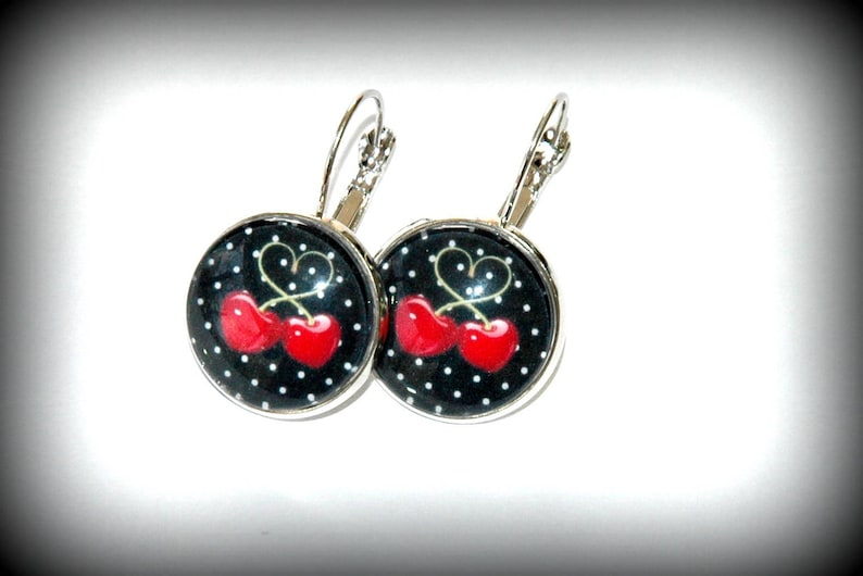 Necklace with Medallion glass cherries black background with dots.