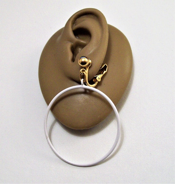 Napier  white and gold round clip on earrings