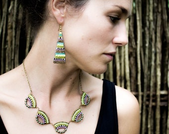 Scallop beadwork necklace in light green, turquoise, lilac and gold with a tribal influence