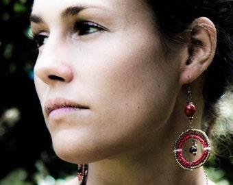 Red, brown and gold large circle Maasai beadwork dangle earrings.